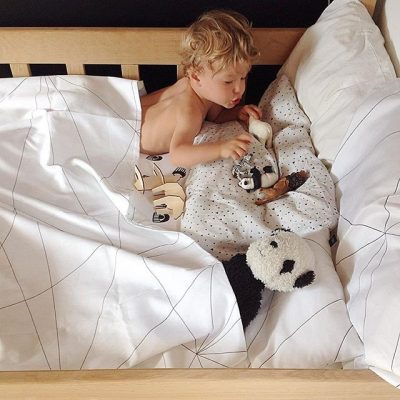 Geometric Web duvet cover with a boy on a bed