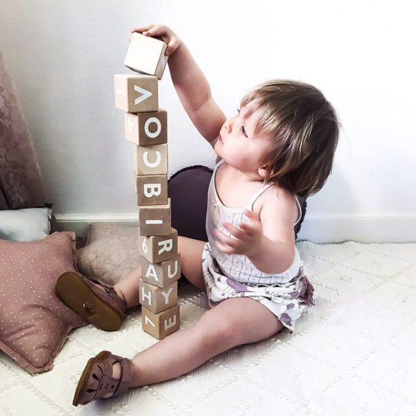 Little girl building a tower